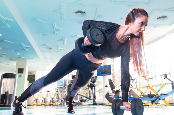 woman doing exercise inside gym 2247179 scaled